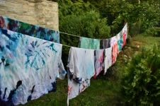 Tie dyed t-shirts drying on the line.