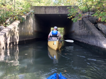 Rob paddling into the tunnel