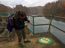 Mrs. Jack takes Signal's picture on the dam.